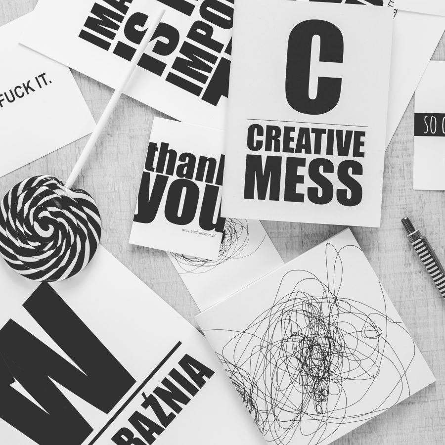 Canva - Top view of black and white typography sentences